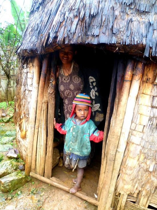 A women and her child welcome us into their home