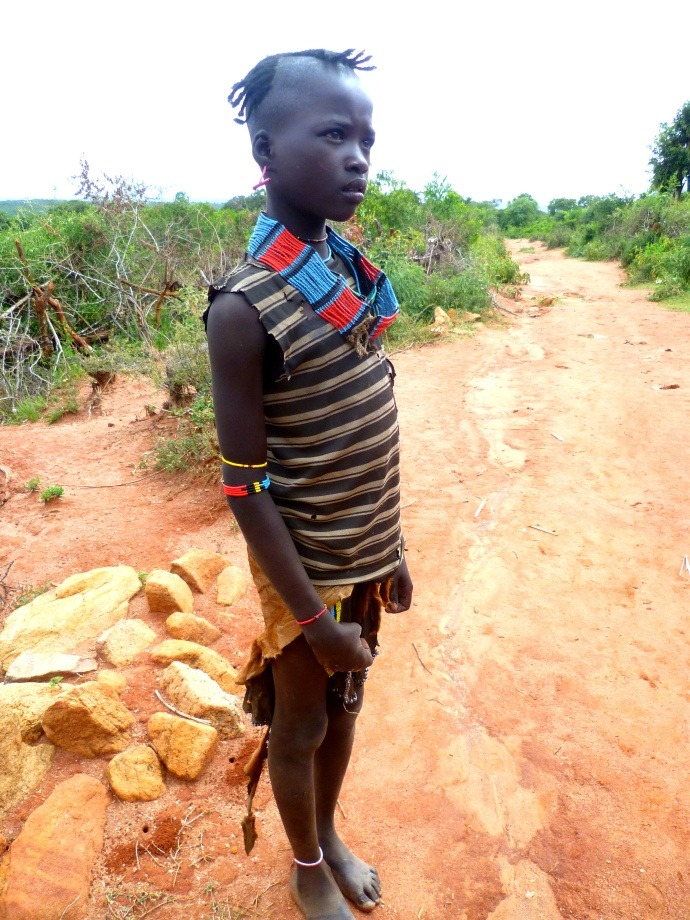 A young man pauses on his walk to let us capture him in all his finery.